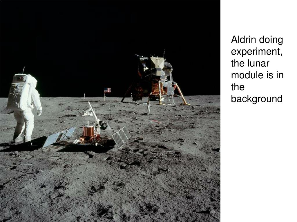 Aldrin doing experiment, the lunar module is in the background