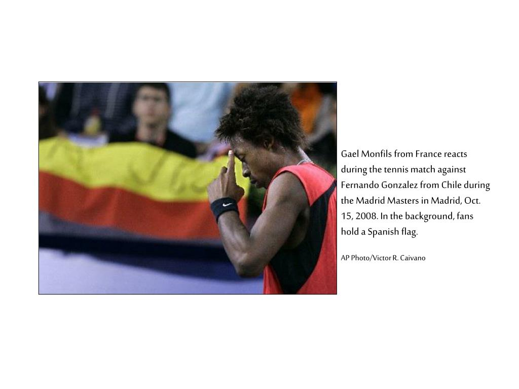Gael Monfils from France reacts during the tennis match against Fernando Gonzalez from Chile during the Madrid Masters in Madrid, Oct. 15, 2008. In the background, fans hold a Spanish flag.
