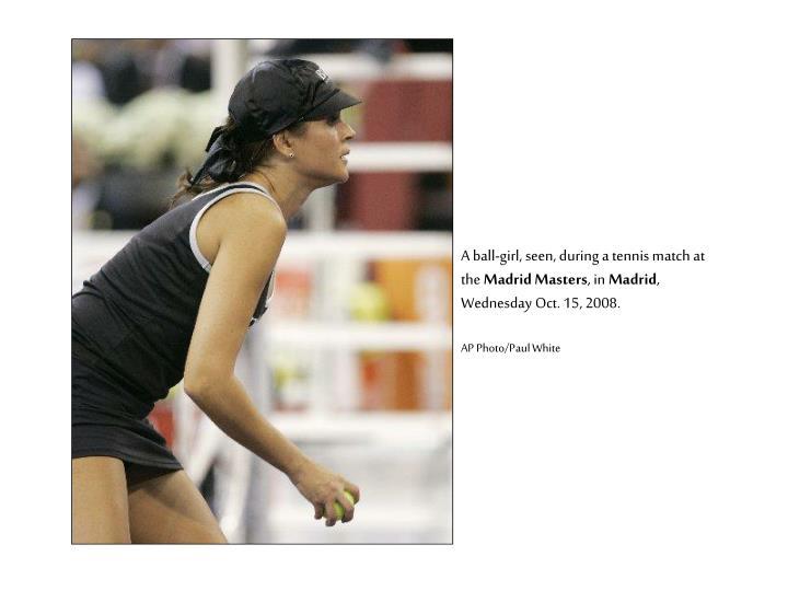 A ball-girl, seen, during a tennis match at the