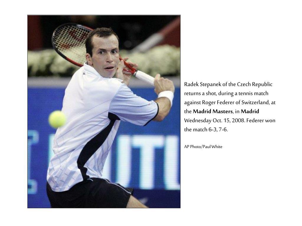 Radek Stepanek of the Czech Republic returns a shot, during a tennis match against Roger Federer of Switzerland, at the