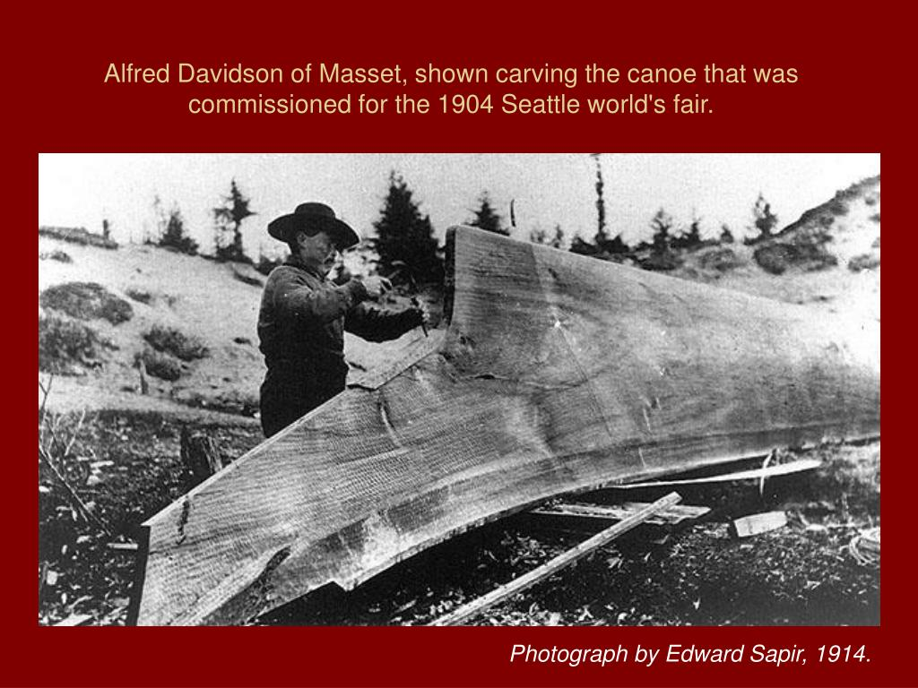 Alfred Davidson of Masset, shown carving the canoe that was commissioned for the 1904 Seattle world's fair.