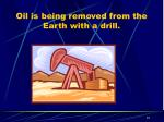 oil is being removed from the earth with a drill