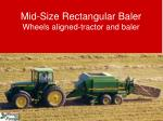 mid size rectangular baler wheels aligned tractor and baler