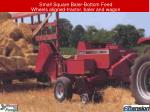 small square baler bottom feed wheels aligned tractor baler and wagon