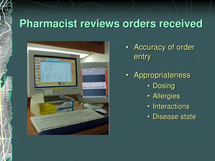 Pharmacist reviews orders received