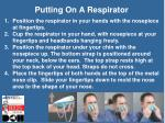 putting on a respirator