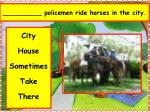 policemen ride horses in the city