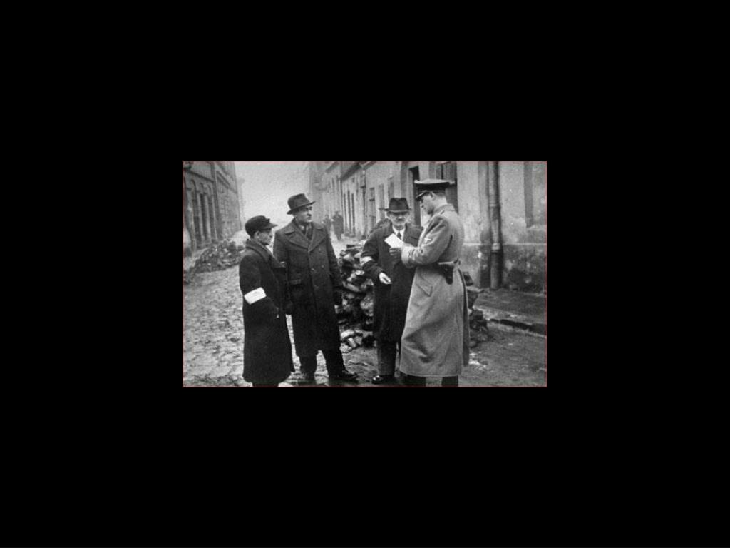 Krakow ghetto German soldier inspects Jewish papers
