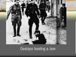 gestapo beating a jew