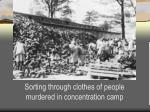 sorting through clothes of people murdered in concentration camp
