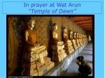 in prayer at wat arun temple of dawn