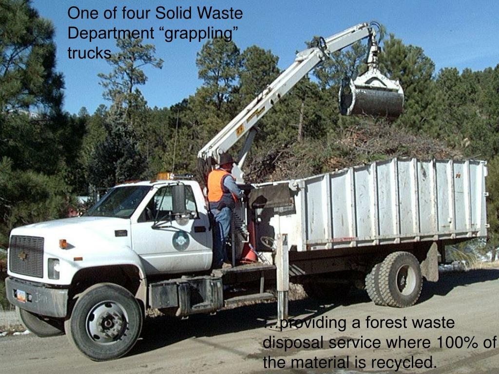 """One of four Solid Waste Department """"grappling"""" trucks …"""