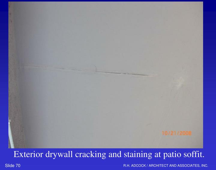 Exterior drywall cracking and staining at patio soffit.