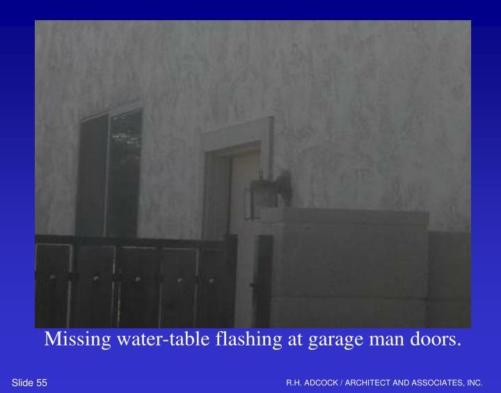 Missing water-table flashing at garage man doors.
