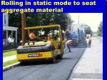 rolling in static mode to seat aggregate material