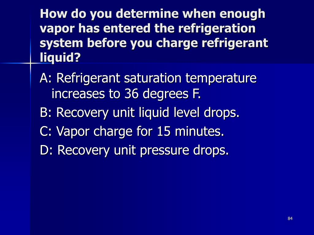 How do you determine when enough vapor has entered the refrigeration system before you charge refrigerant liquid?