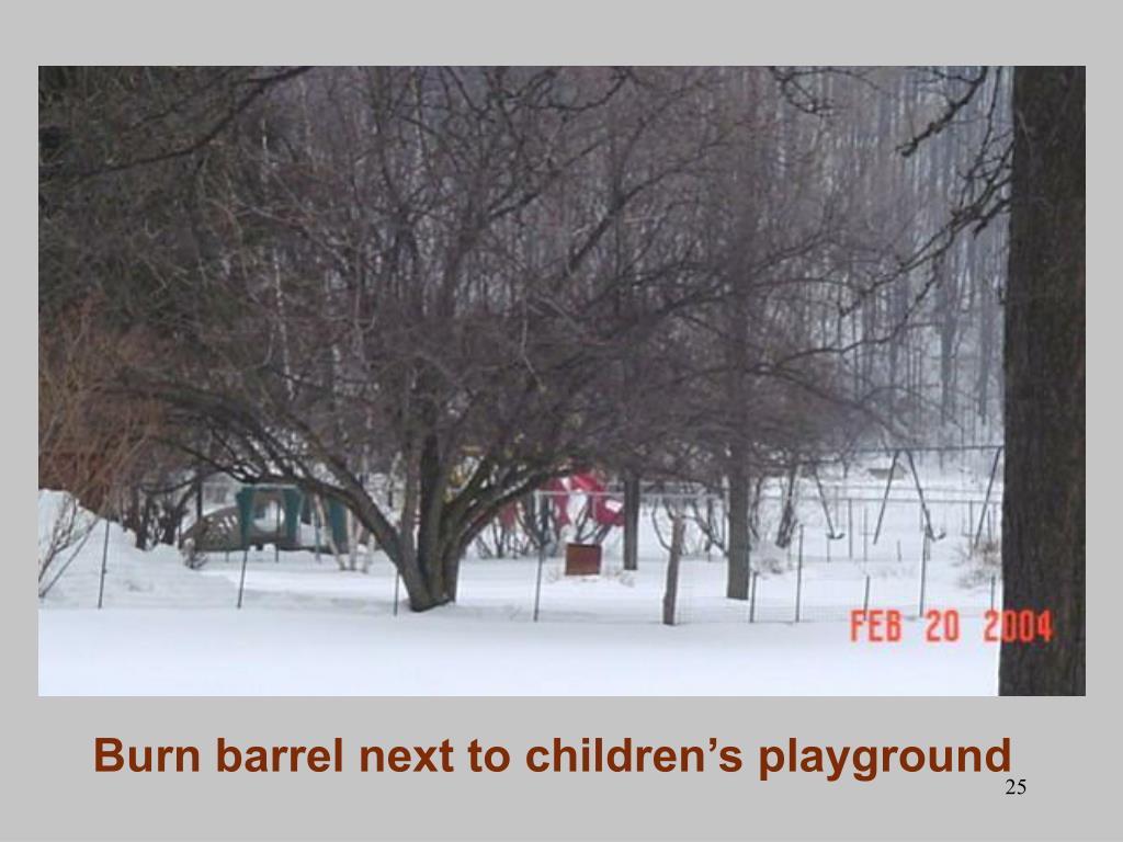 Burn barrel next to children's playground