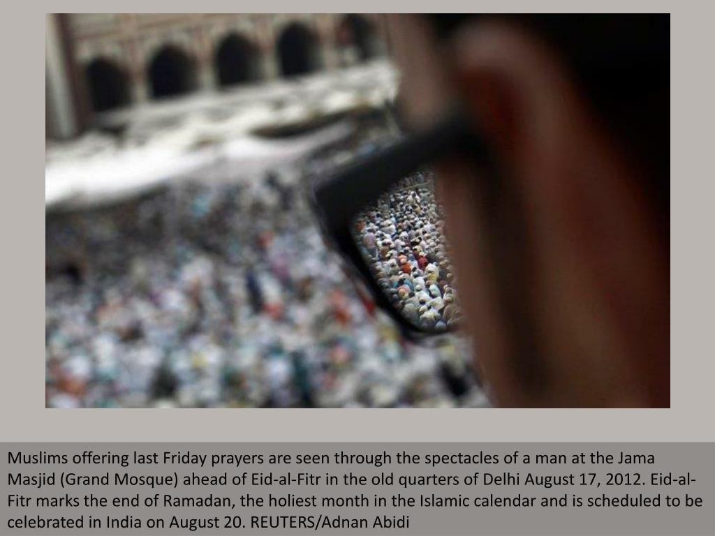 Muslims offering last Friday prayers are seen through the spectacles of a man at the Jama Masjid (Grand Mosque) ahead of Eid-al-Fitr in the old quarters of Delhi August 17, 2012. Eid-al-Fitr marks the end of Ramadan, the holiest month in the Islamic calendar and is scheduled to be celebrated in India on August 20. REUTERS/Adnan Abidi