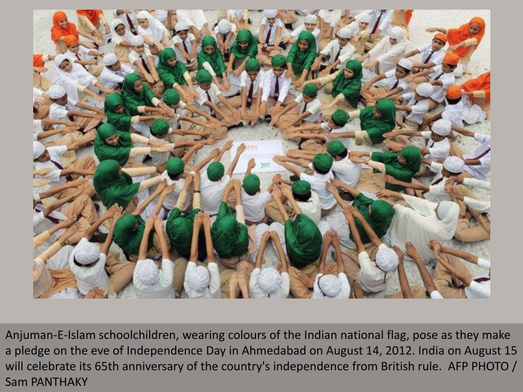 Anjuman-E-Islam schoolchildren, wearing colours of the Indian national flag, pose as they make a pledge on the eve of Independence Day in Ahmedabad on August 14, 2012. India on August 15 will celebrate its 65th anniversary of the country's independence from British rule.  AFP PHOTO / Sam PANTHAKY