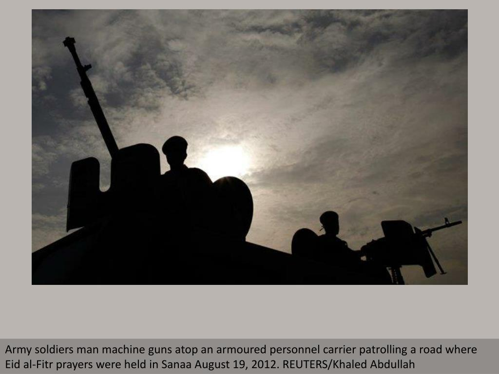 Army soldiers man machine guns atop an armoured personnel carrier patrolling a road where Eid al-Fitr prayers were held in Sanaa August 19, 2012. REUTERS/Khaled Abdullah