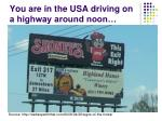 you are in the usa driving on a highway around noon