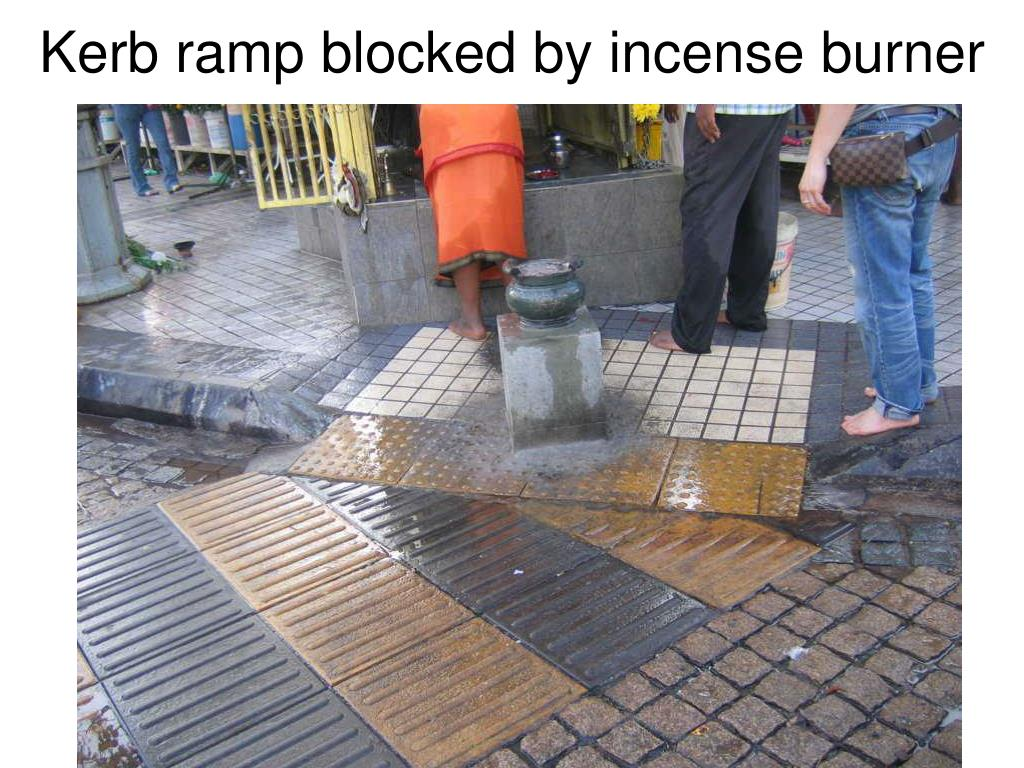 Kerb ramp blocked by incense burner