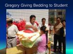 gregory giving bedding to student