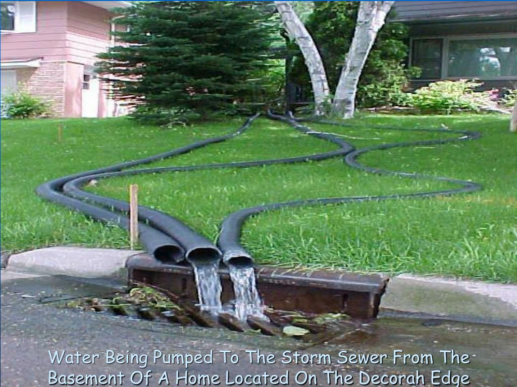 Water Being Pumped To The Storm Sewer From The Basement Of A Home Located On The Decorah Edge