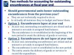 two methods for accounting for outstanding encumbrances at fiscal year end