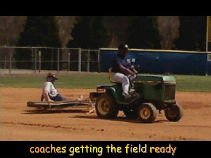 coaches getting the field ready