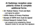 at radiology reception area patients review complete additional forms