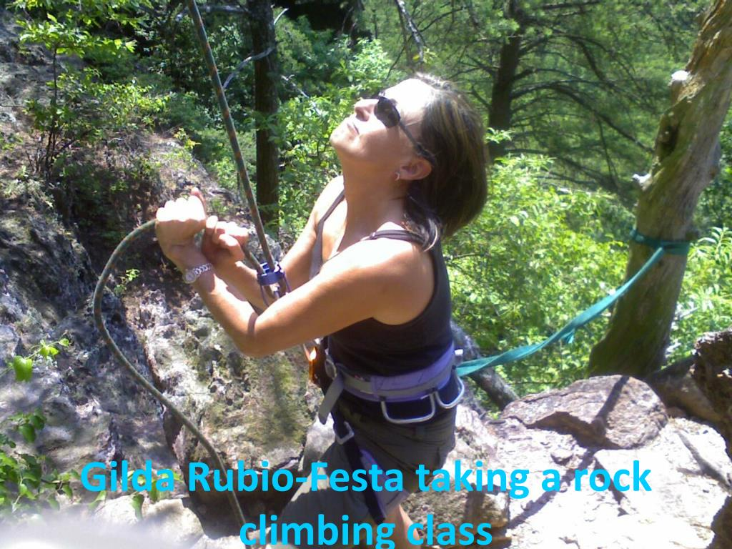 Gilda Rubio-Festa taking a rock climbing class