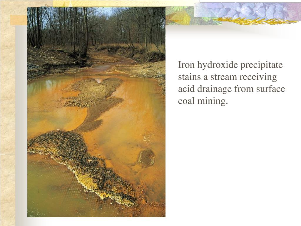 Iron hydroxide precipitate stains a stream receiving acid drainage from surface coal mining.