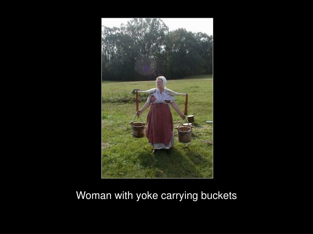 Woman with yoke carrying buckets