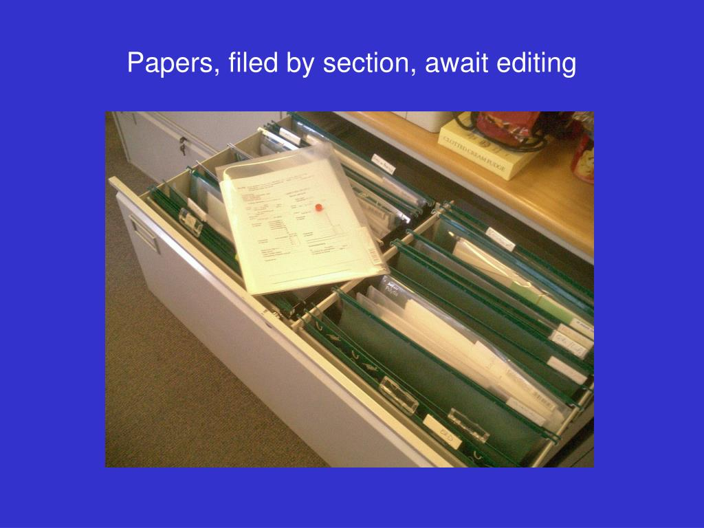 Papers, filed by section, await editing