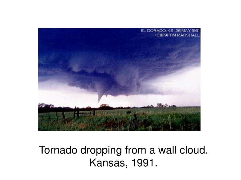 Tornado dropping from a wall cloud.  Kansas, 1991.