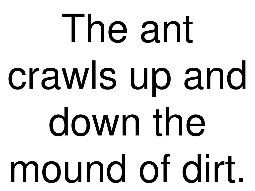 The ant crawls up and down the mound of dirt.