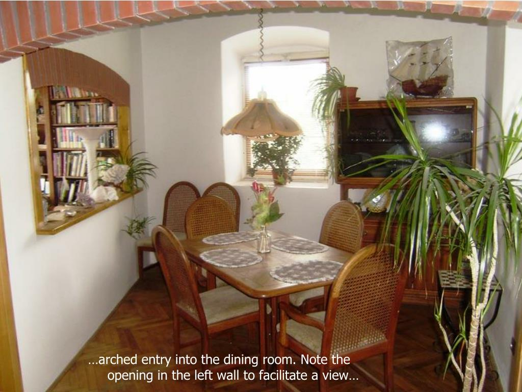 …arched entry into the dining room. Note the opening in the left wall to facilitate a view…