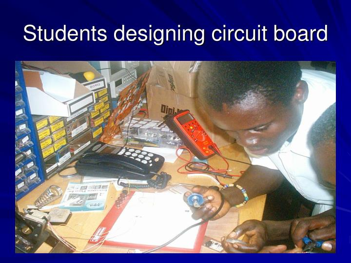 Students designing circuit board